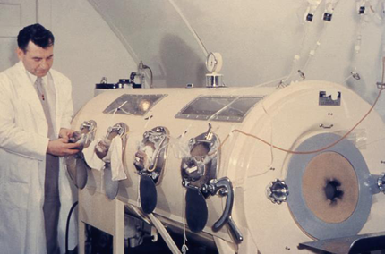 A technician calibrating an iron lung machine