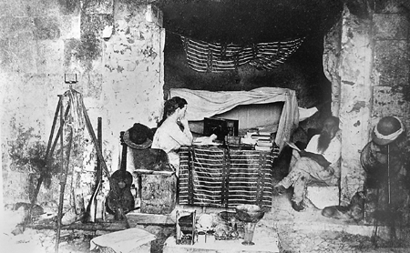 Alice and Augustus Le Plongeon camped in the center room of the Governor's Palace at Uxmal during their field work there in 1876